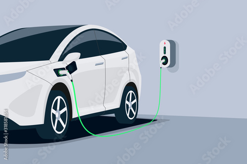 Fotografía Electric car charging in underground garage home plugged to charger station