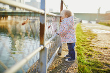 One Year Old Girl Standing Nex...