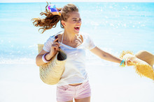 Woman With Beach Straw Bag And...