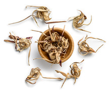 Dry Artichoke Flowers On A Whi...