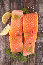Salmon Fillet, Lemon And Dill On Wood Background