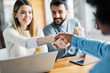 canvas print picture - young couple shaking hands deal contract real estate investment