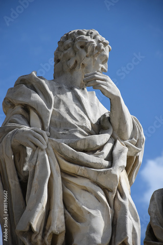 Fotografia, Obraz Limestone statue of a saint or sculpture of an apostle designed by Kacper Bażank