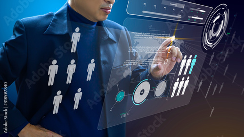Платно Business administrator in action of manpower or human resource planning or business organisation on a futuristic augmented reality virtual dashboard