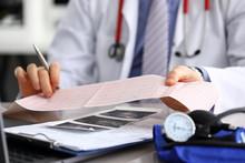 Doctor Explains Cardiogram Data, Consultation.