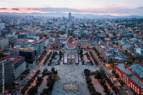 """Aerial photography with miniature effect of the sunset at the """"Monumento a la Revolución"""" in Mexico City"""