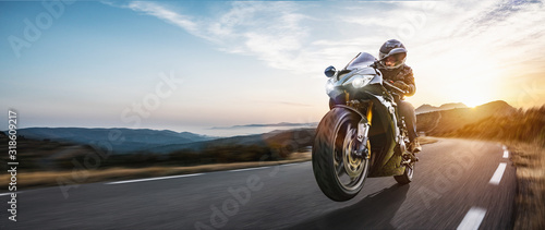Fast motorbike on the coastal road riding Wallpaper Mural