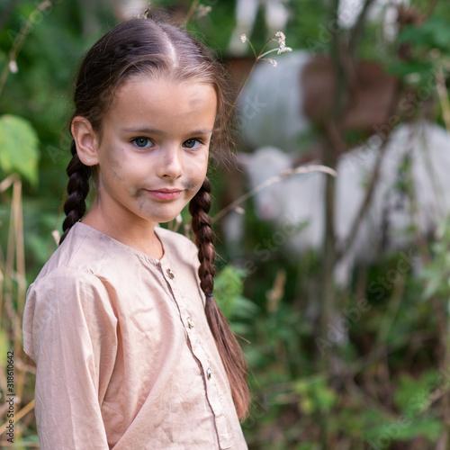 Little girl goatherd in forest Fototapet