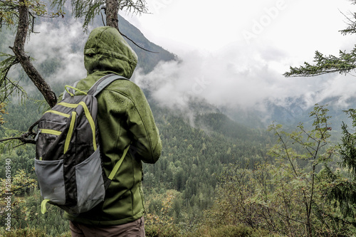 Obraz Rear View Of Male Hiker Standing Against Mountains - fototapety do salonu