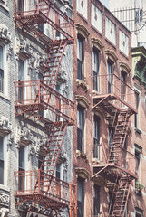 FototapetaManhattan old residential buildings with fire escapes, color toning applied, New York City, USA.