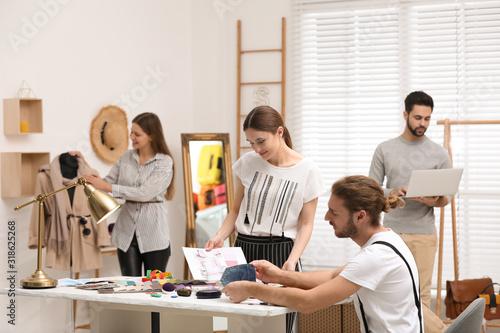 Fototapeta Fashion designers creating new clothes in studio obraz na płótnie