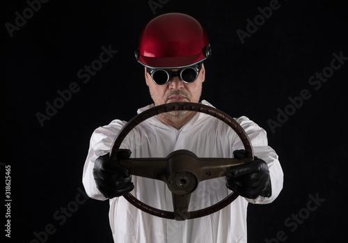 Fototapeta racer in a helmet in a white overalls