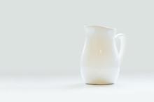 White Porcelain Milk Jug On Wh...