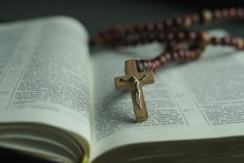 Opened Bible And Wooden Rosary