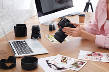 Professional Photographer With Camera Working At Table In Office, Closeup