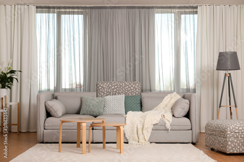 Windows with stylish curtains in living room interior Wallpaper Mural