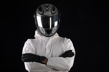 Racer In A Helmet In A White Overalls