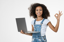 Little African Girl Holding Laptop With OK Sign Isolated On White Background.