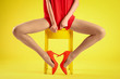 canvas print picture - Woman wearing tights and stylish red shoes on yellow background, closeup