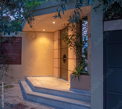 Valokuva luxury house entramce metalic door early in the evening, Athens Greece