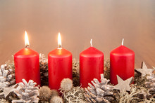 Close-Up Of Red Lit Candles Amidst Christmas Decorations At Night