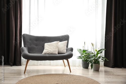 Fototapety, obrazy: Comfortable sofa near window with elegant curtains in room