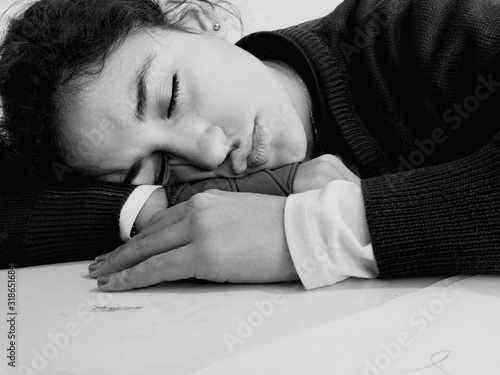 Teenage Girl Sleeping On Table Canvas Print