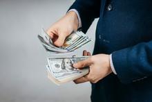 Businessman Counts Real Money In Hands