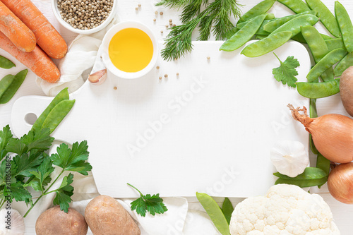 Obraz Fresh raw vegetables on white kitchen table, culinary background, top view - fototapety do salonu