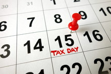 Tax Day Marked On Calendar