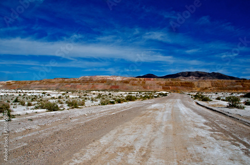 Photo Very wide dirt roads lead away from mine to accommodate  large mining trucks, ne