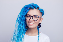 Portrait Of A Woman With Blue Dreadlocks And A Piercing. Informal Young Woman.