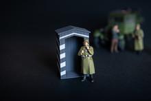 A Figure Of A Man In A Militar...
