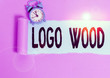 canvas print picture - Text sign showing Logo Wood. Business photo showcasing Recognizable design or symbol of a company inscribed on wood Alarm clock and torn cardboard placed above plain pastel table backdrop
