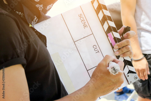 Midsection Of Woman Writing On Clapperboard Poster Mural XXL