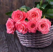 Pink Roses Over Wooden Table. ...