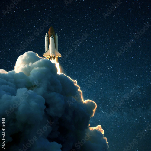 Canvas-taulu Space rocket launches into space against a starry blue sky
