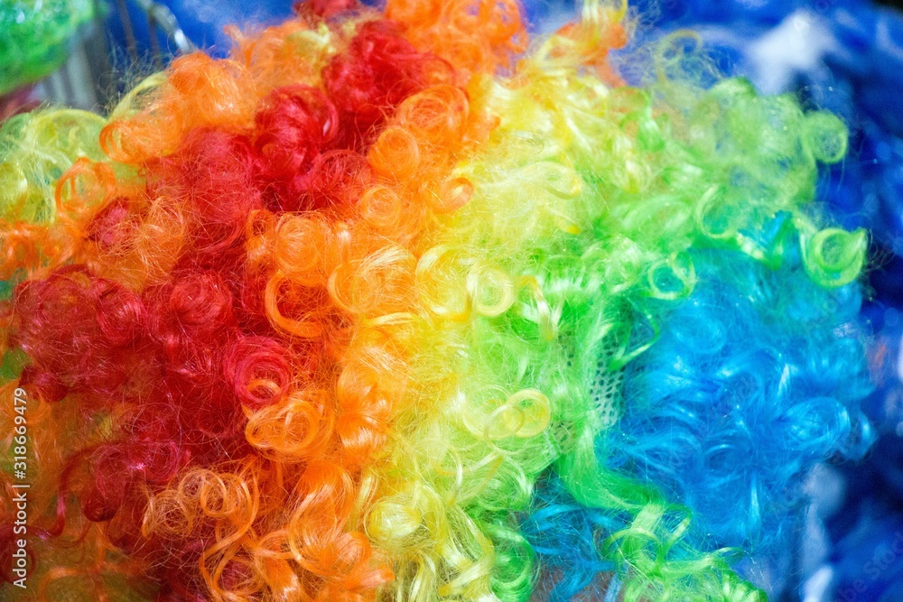 Fototapeta Closeup shot of a rainbow-colored wig for clowns