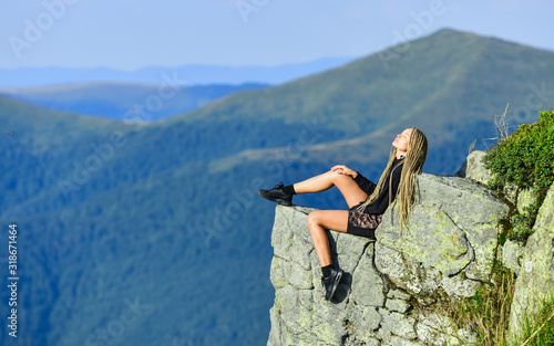 Fototapeta leadership concept. rock climbing skill. reaching the top. woman relax on mountain cliff. feel freedom. extremely free. alpinism lifestyle. way to success. mountain traveling and hiking. being leader obraz