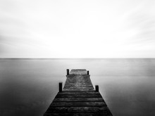 Greyscale Of A Wooden Bridge O...