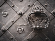 Closeup Shot Of An Ancient Door In Black With Metal Handle