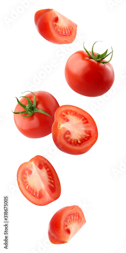 Fototapeta falling tomatoes isolated on a white background with a clipping path. obraz