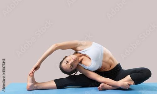 Fotografie, Obraz Young beautiful woman doing Yoga on the floor