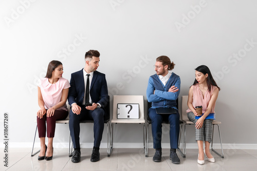 Young people waiting for job interview indoors Canvas Print