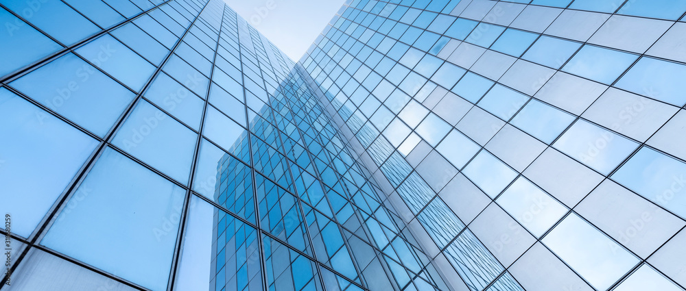 Fototapeta glass facades of modern office buildings and reflection of blue sky