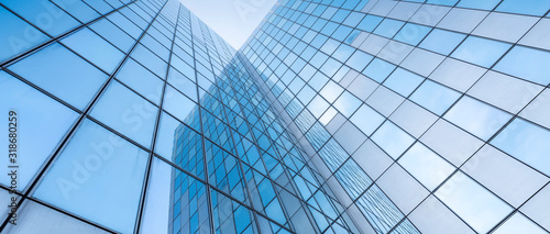 glass facades of modern office buildings and reflection of blue sky - fototapety na wymiar