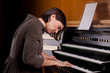 canvas print picture - Organist playing a pipe organ, closeup view