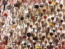 Full Frame Shot Of Keys Hanging On Wooden Wall
