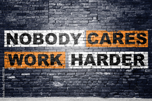 Fotomural Nobody cares work harder saying lettering Graffiti on Brick Wall