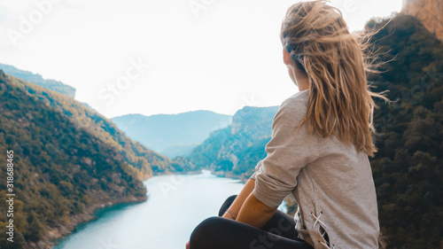 Fotografie, Obraz caucasian girl sitting on a ravine